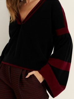 A luxurious cashmere knit with with statement sleeves